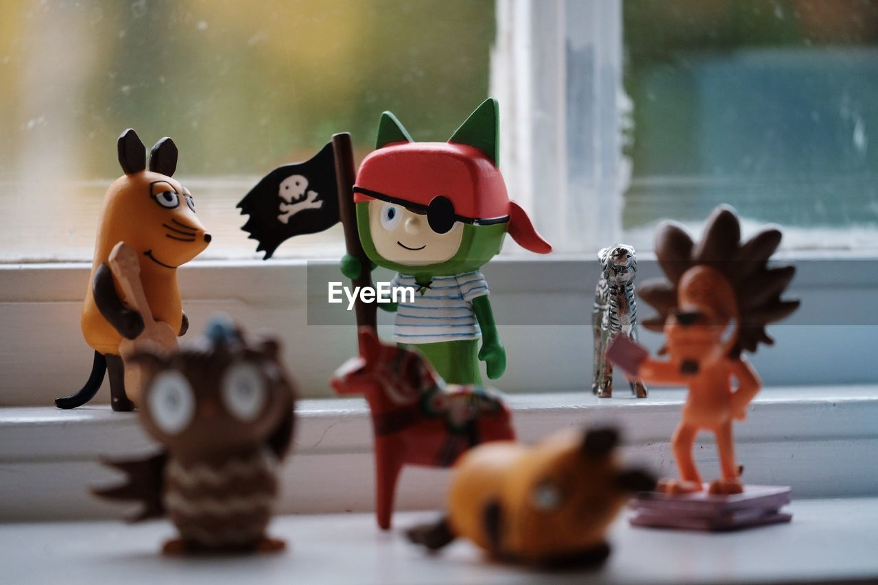 representation, art and craft, human representation, creativity, toy, figurine, male likeness, craft, no people, still life, sculpture, selective focus, mammal, celebration, indoors, close-up, table