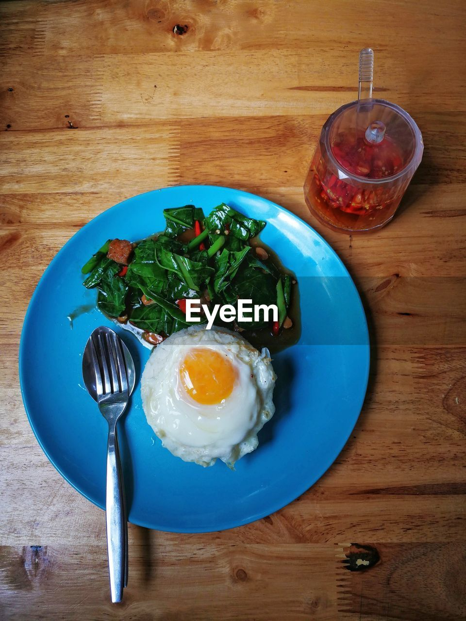 food and drink, food, egg, table, kitchen utensil, freshness, healthy eating, ready-to-eat, eating utensil, wellbeing, indoors, wood - material, breakfast, meal, fried egg, still life, no people, directly above, plate, household equipment, fried, egg yolk, glass, sunny side up, boiled egg