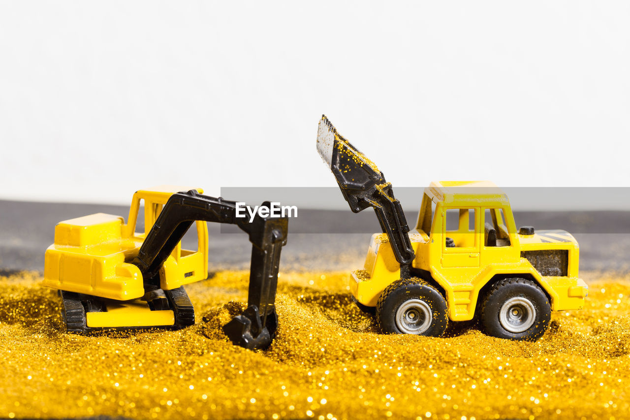 Close-Up Of Toy Construction Machinery In Sand