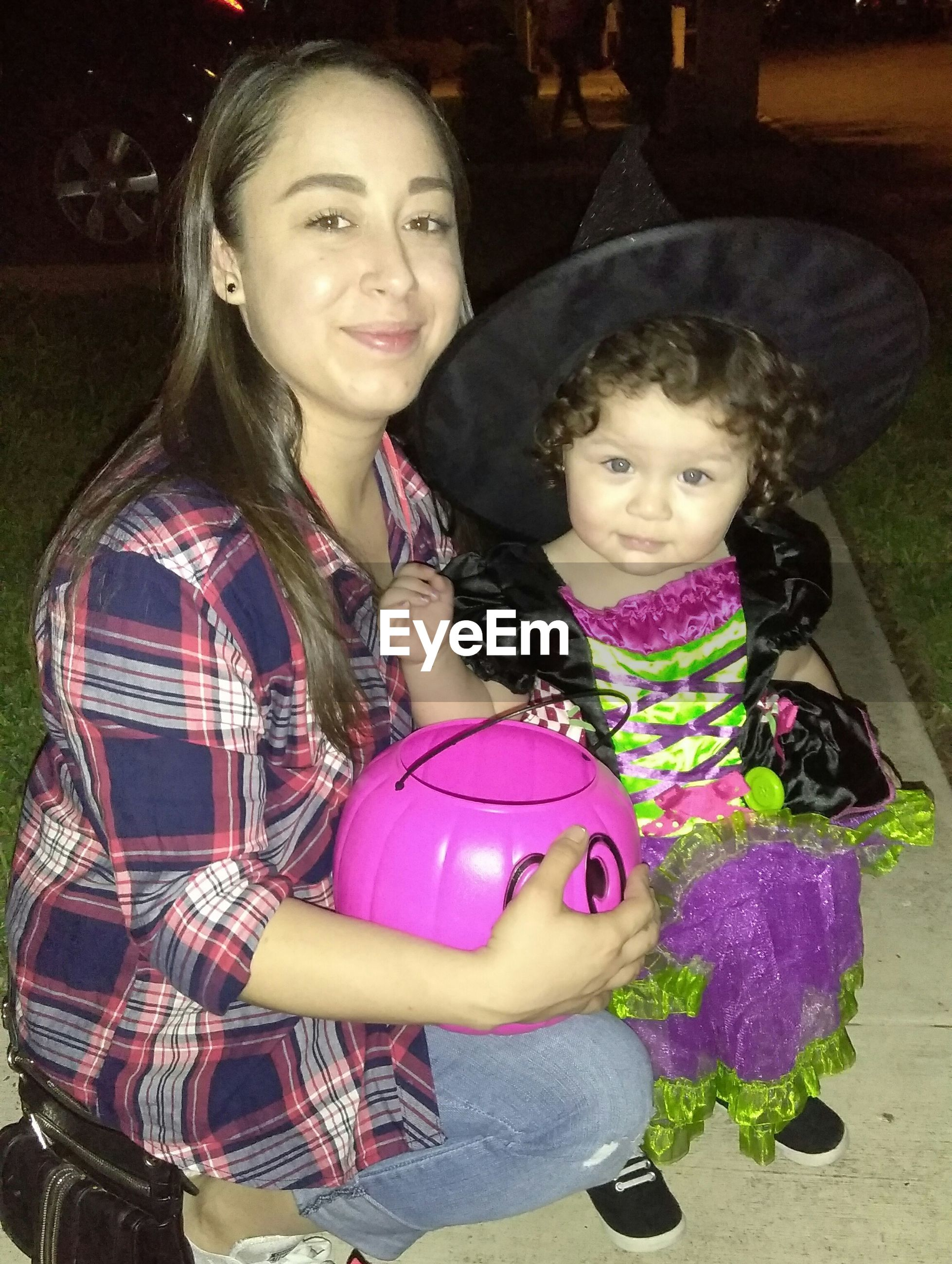 Portrait of mother with daughter during halloween
