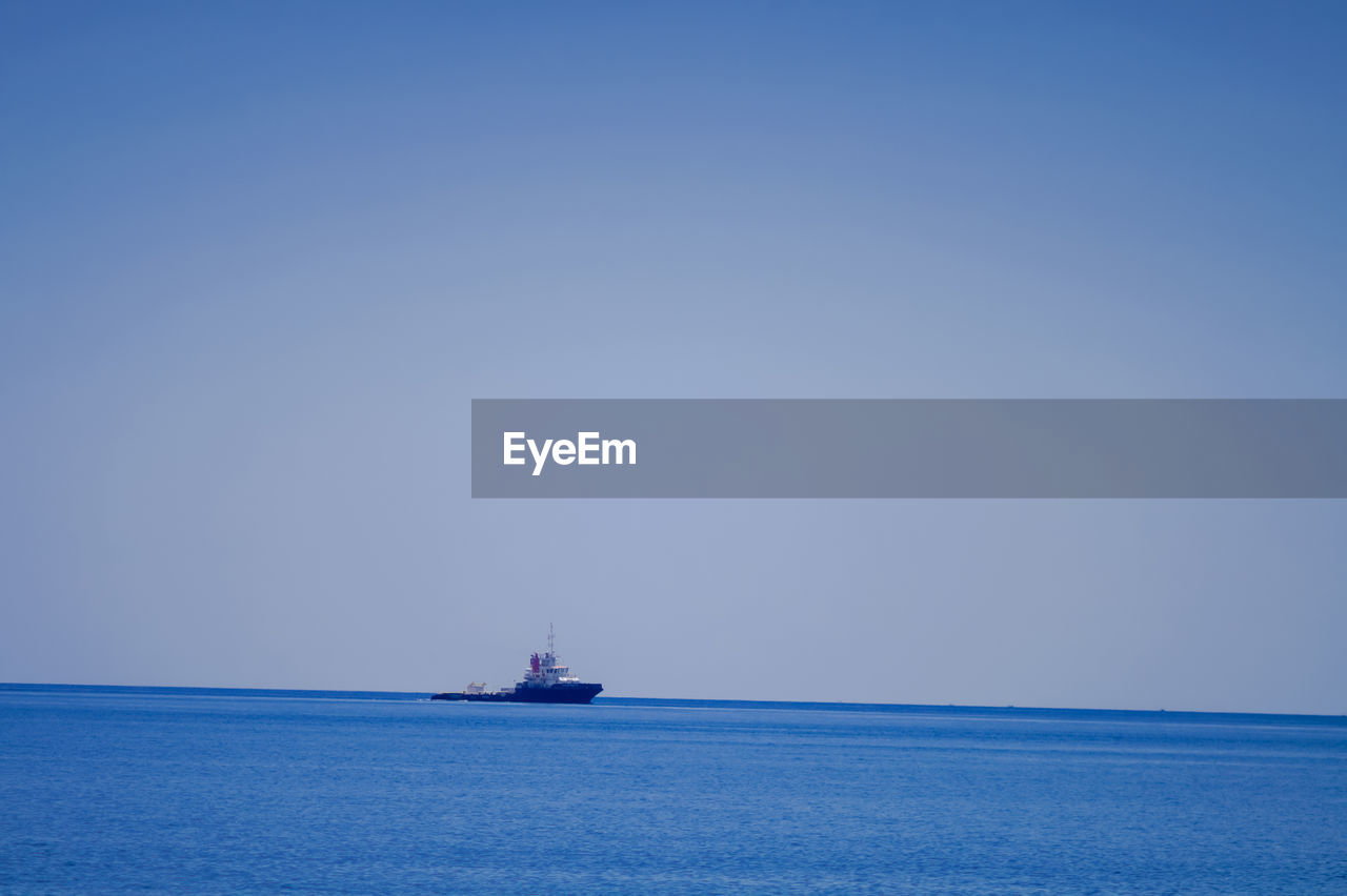 sea, water, nautical vessel, sky, transportation, horizon over water, mode of transportation, horizon, copy space, waterfront, ship, blue, sailing, nature, beauty in nature, no people, clear sky, scenics - nature, day, outdoors, sailboat
