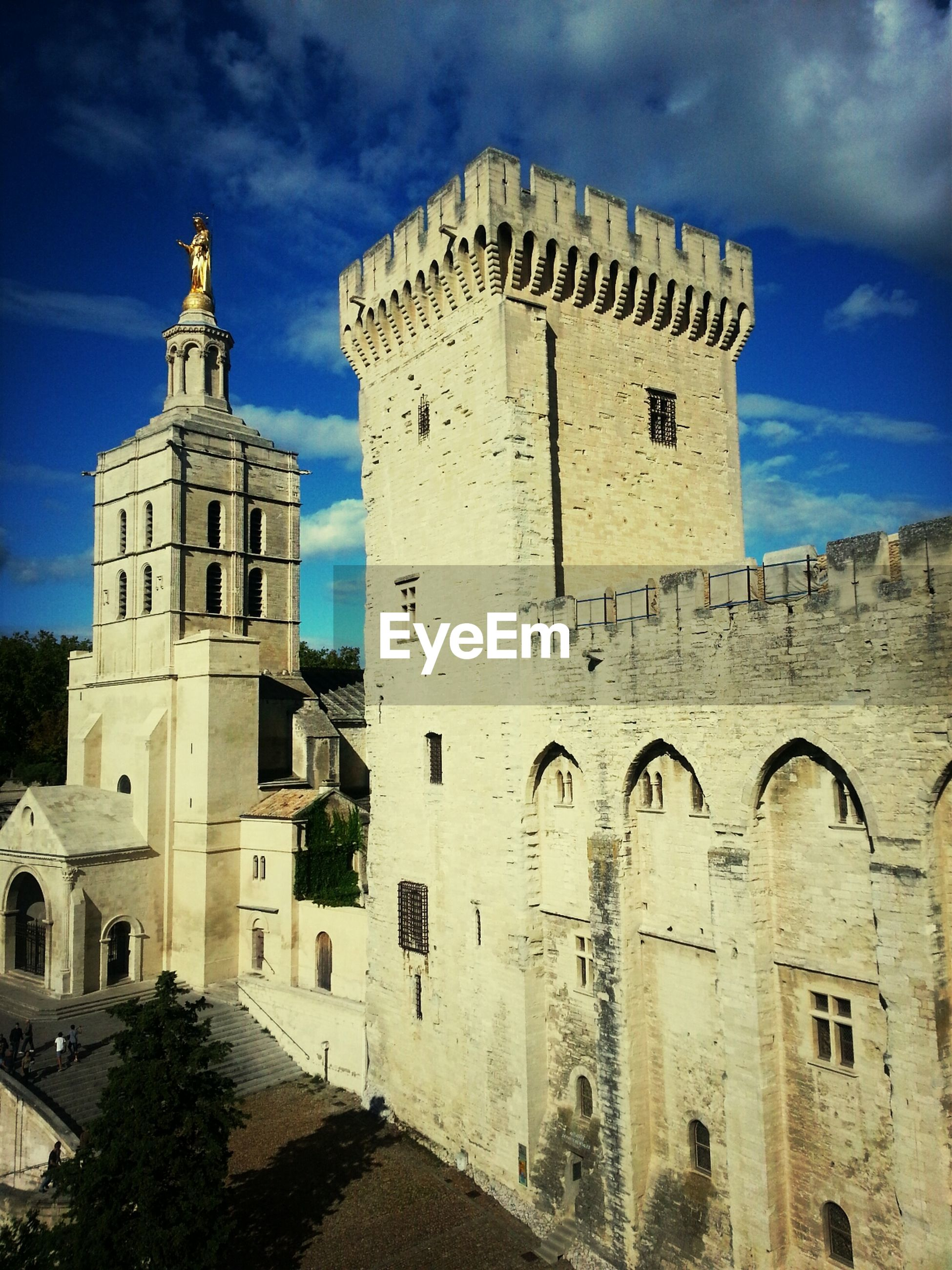 architecture, building exterior, built structure, sky, church, religion, place of worship, history, low angle view, cloud - sky, spirituality, old, tower, cloud, cathedral, blue, the past, arch