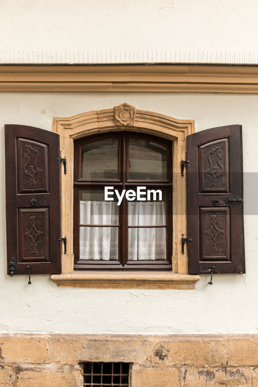window, architecture, built structure, building exterior, building, no people, day, wood - material, door, wall - building feature, entrance, outdoors, closed, house, brown, safety, security, wall, glass - material, protection, window frame