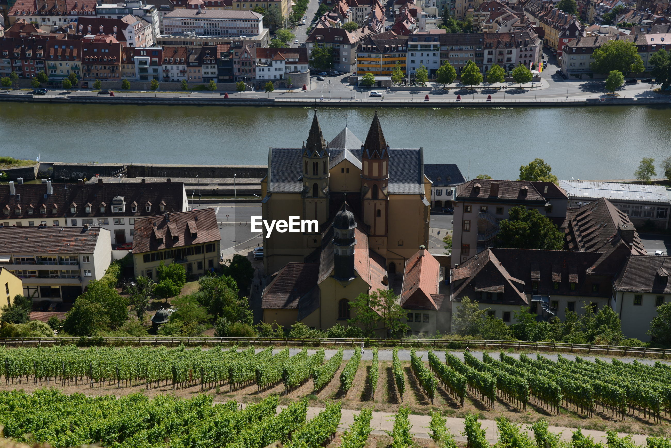HIGH ANGLE VIEW OF BUILDINGS BY RIVER