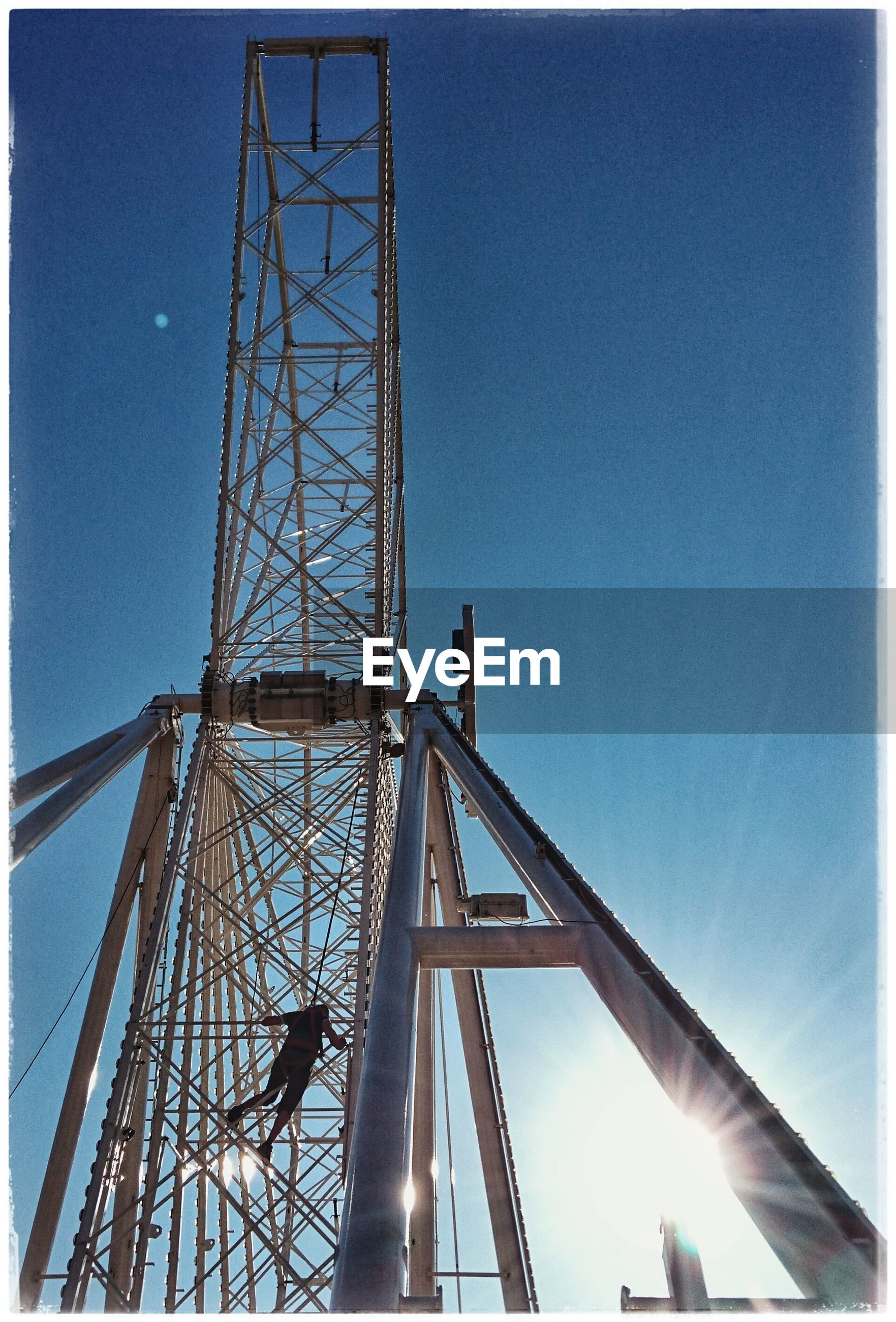 low angle view, tower, sky, clear sky, dusk, blue, cloud, engineering, communications tower, iron - metal, outdoors, tall - high, day, tall, tourism, famous place, skyscraper, no people, electricity tower, scenics