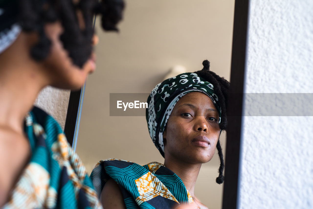 Woman Reflecting On Mirror At Home