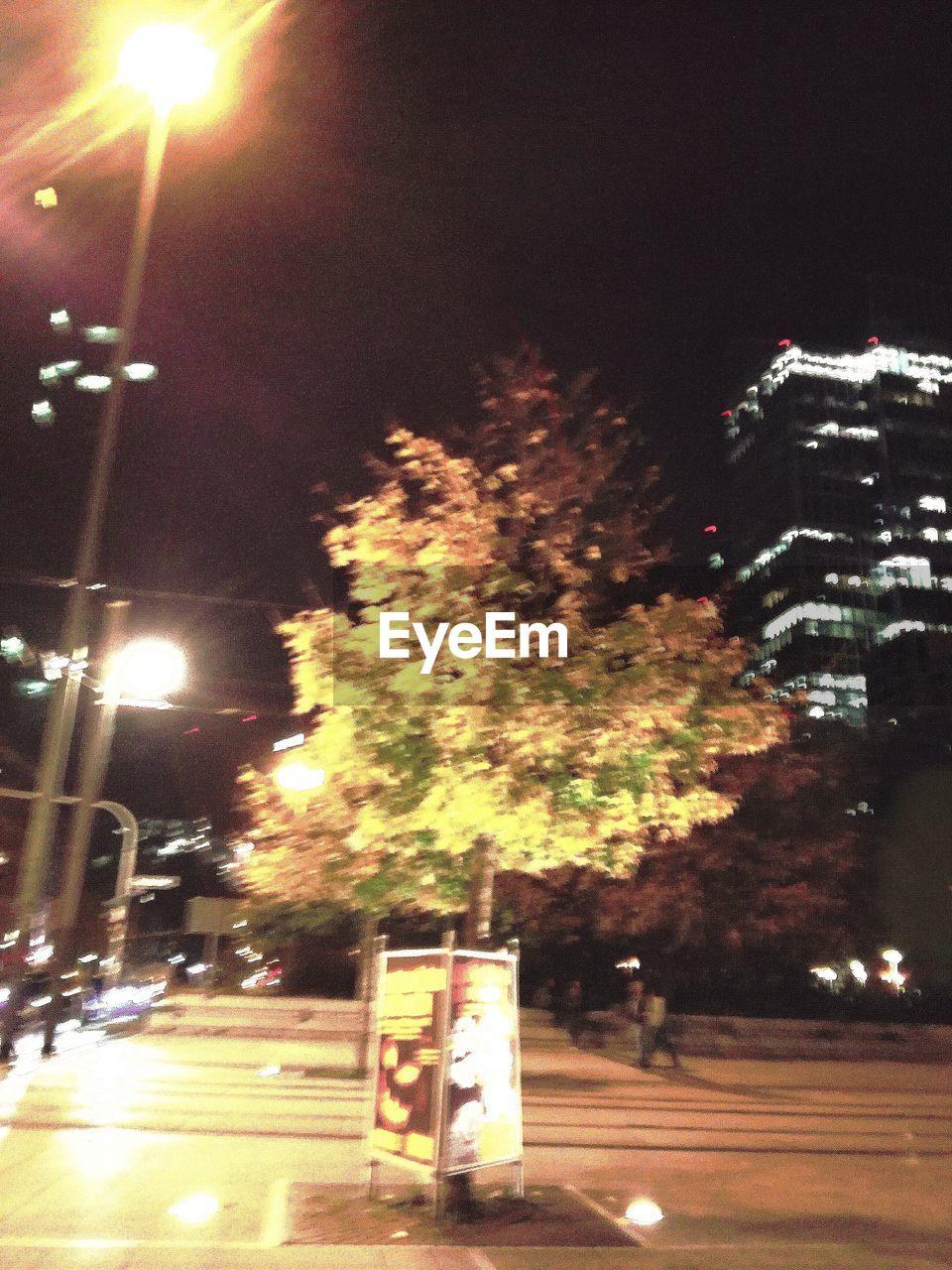 night, illuminated, street, road, transportation, city, tree, city life, car, outdoors, street light, building exterior, no people, architecture, sky