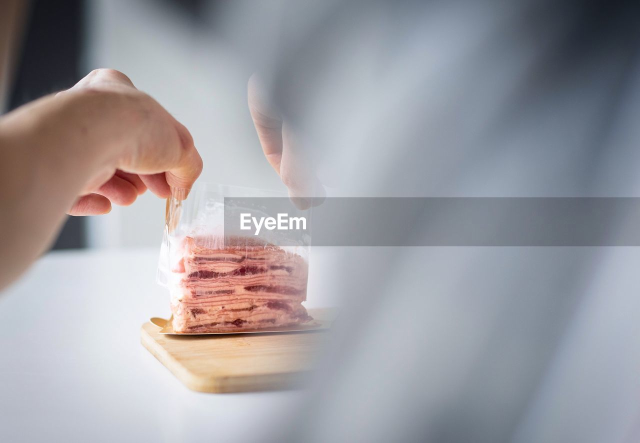 human hand, hand, human body part, one person, food and drink, selective focus, holding, real people, sweet food, food, temptation, indoors, unrecognizable person, lifestyles, sweet, freshness, adult, indulgence, women, finger, preparing food