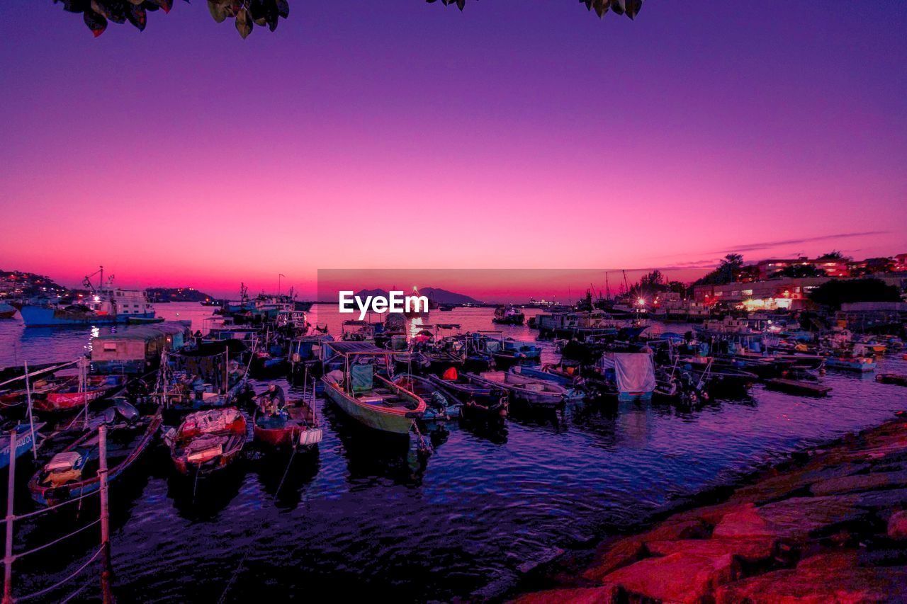 sky, water, architecture, illuminated, sunset, dusk, nature, built structure, transportation, nautical vessel, city, building exterior, clear sky, incidental people, business, restaurant, moored, outdoors, purple
