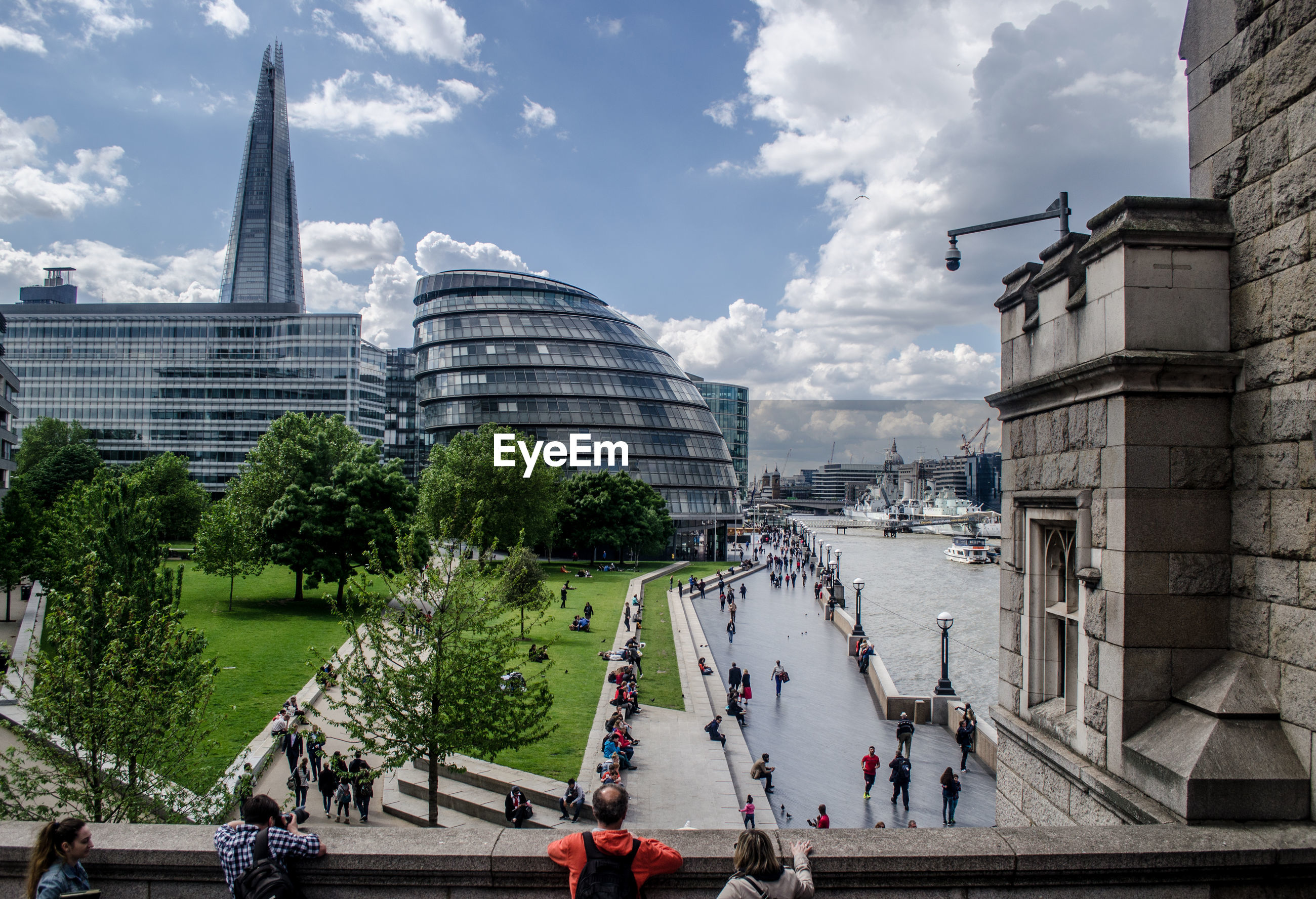 High angle view of people walking by city hall and shard london bridge in city
