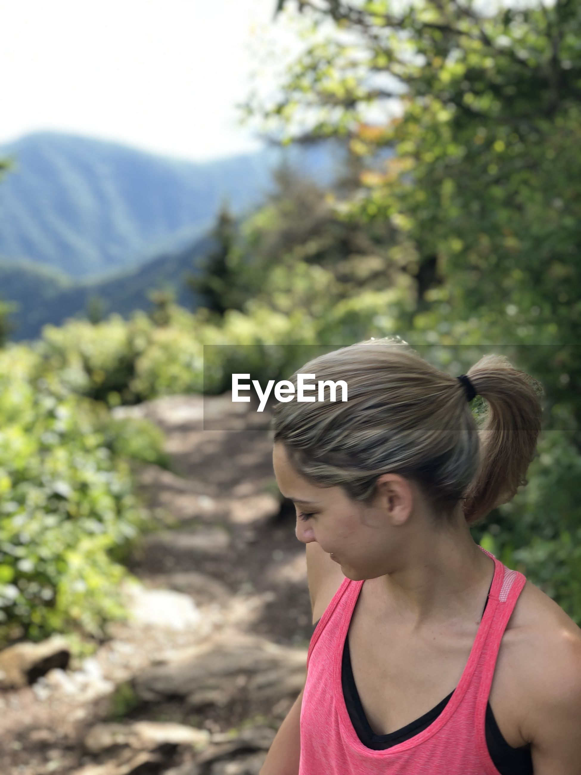Portrait of woman looking at mountains