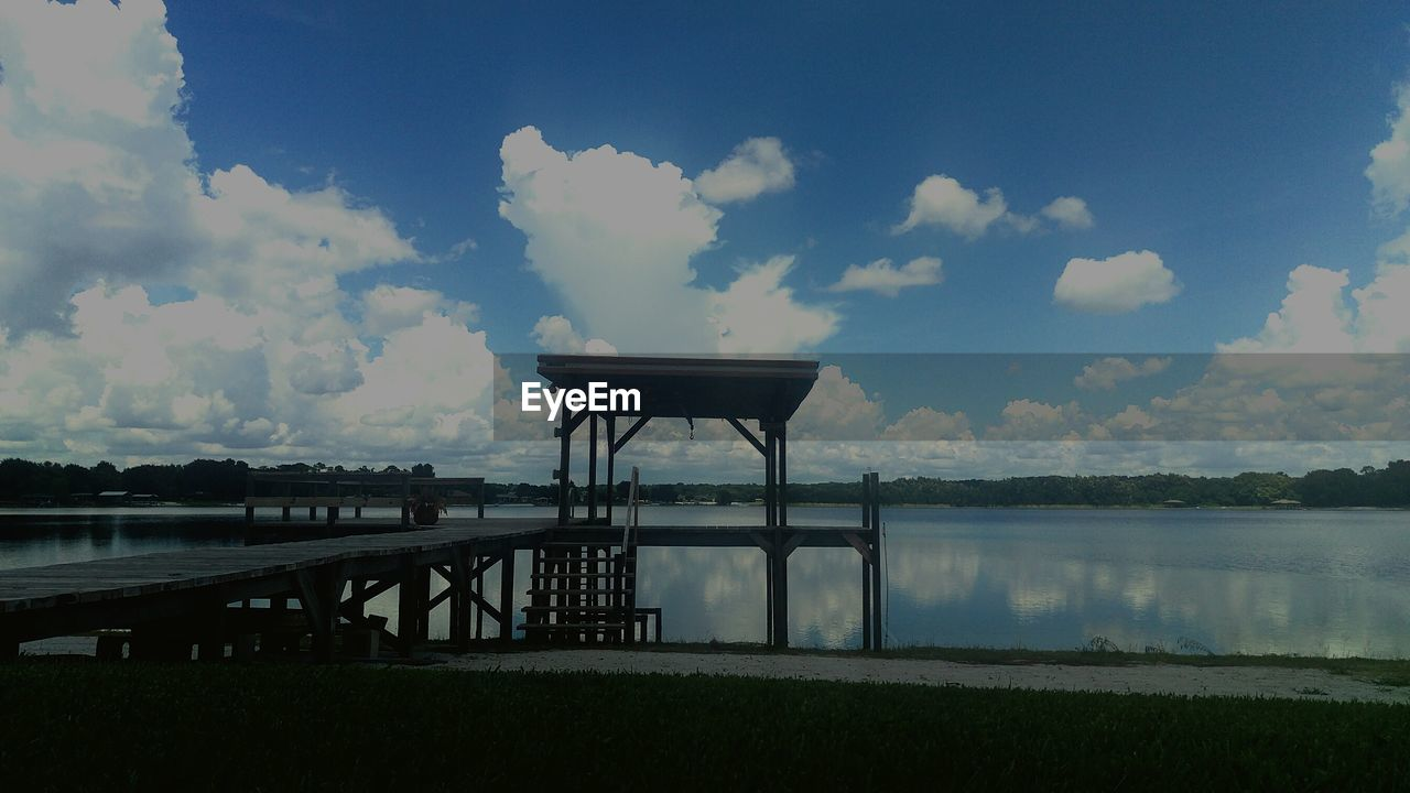 water, sky, cloud - sky, lake, no people, nature, day, outdoors, architecture, beauty in nature
