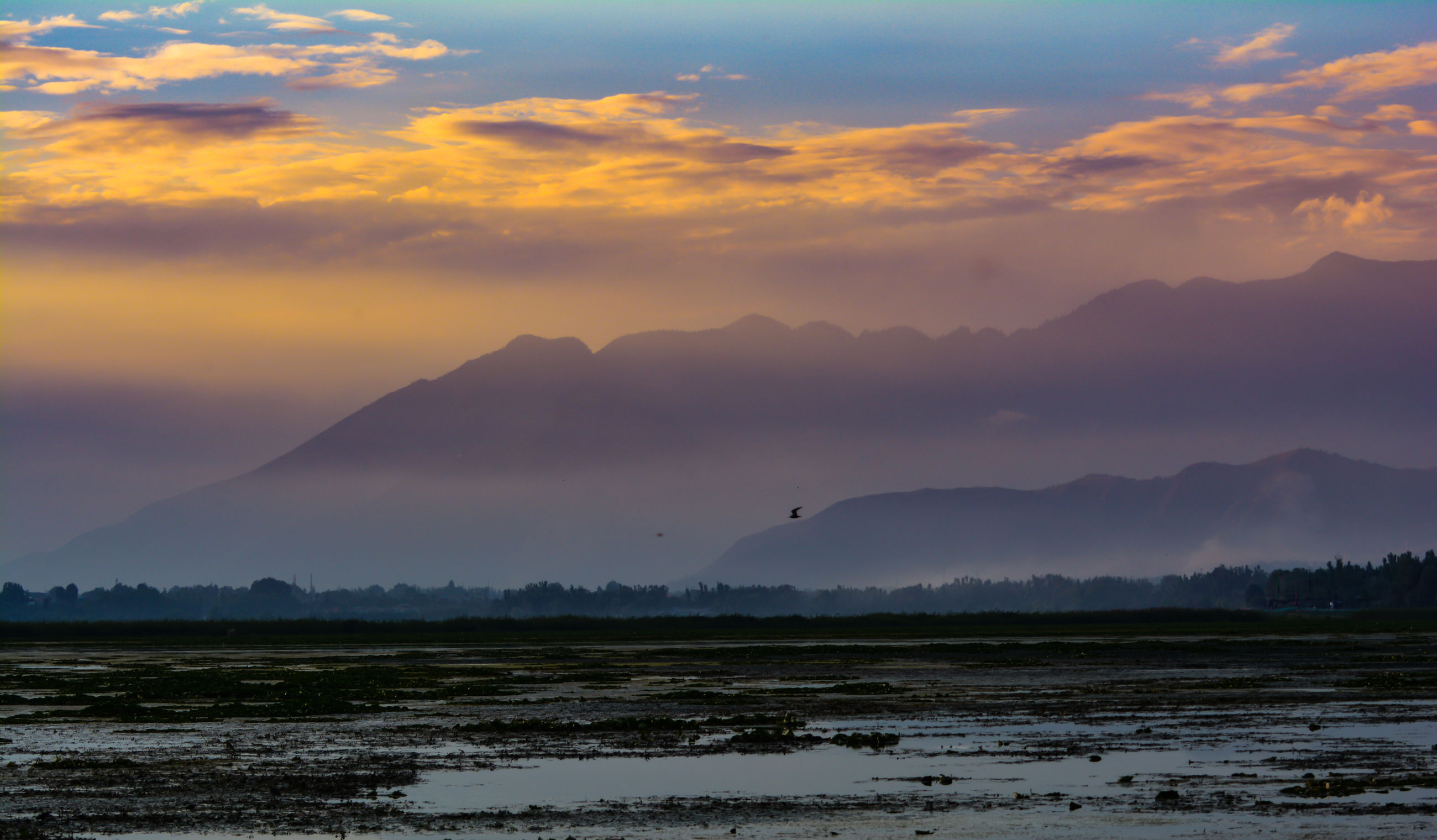 SCENIC VIEW OF SUNSET OVER MOUNTAINS