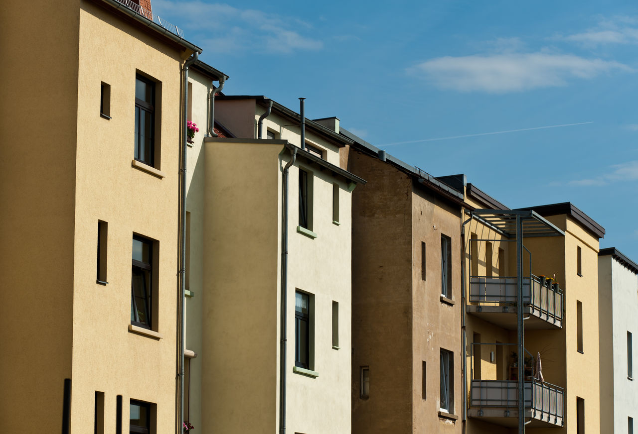 building exterior, architecture, built structure, window, building, sky, residential district, low angle view, no people, nature, sunlight, day, outdoors, cloud - sky, house, city, blue, shadow, sunny, side by side, apartment
