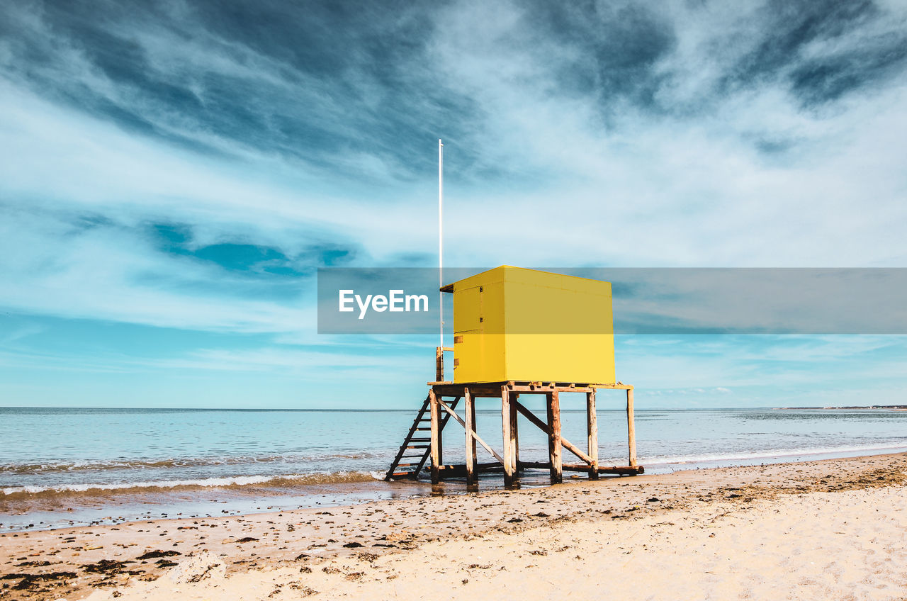 sky, beach, land, water, cloud - sky, sea, horizon over water, sand, horizon, man made structure, lifeguard hut, hut, nature, safety, built structure, security, scenics - nature, tranquil scene, beauty in nature, no people, outdoors