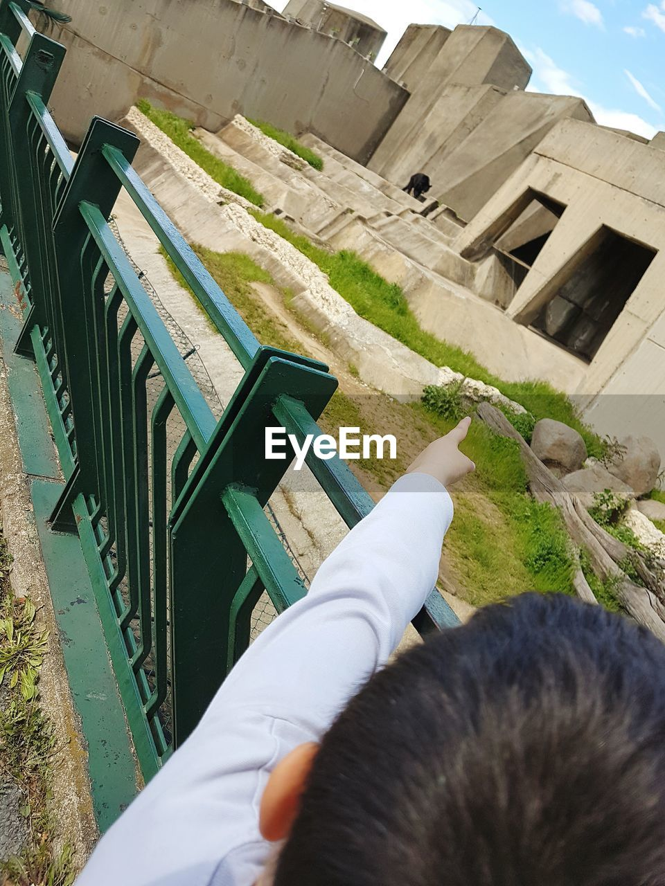 real people, one person, high angle view, day, outdoors, lifestyles, grass, men, human hand, human body part, nature, architecture