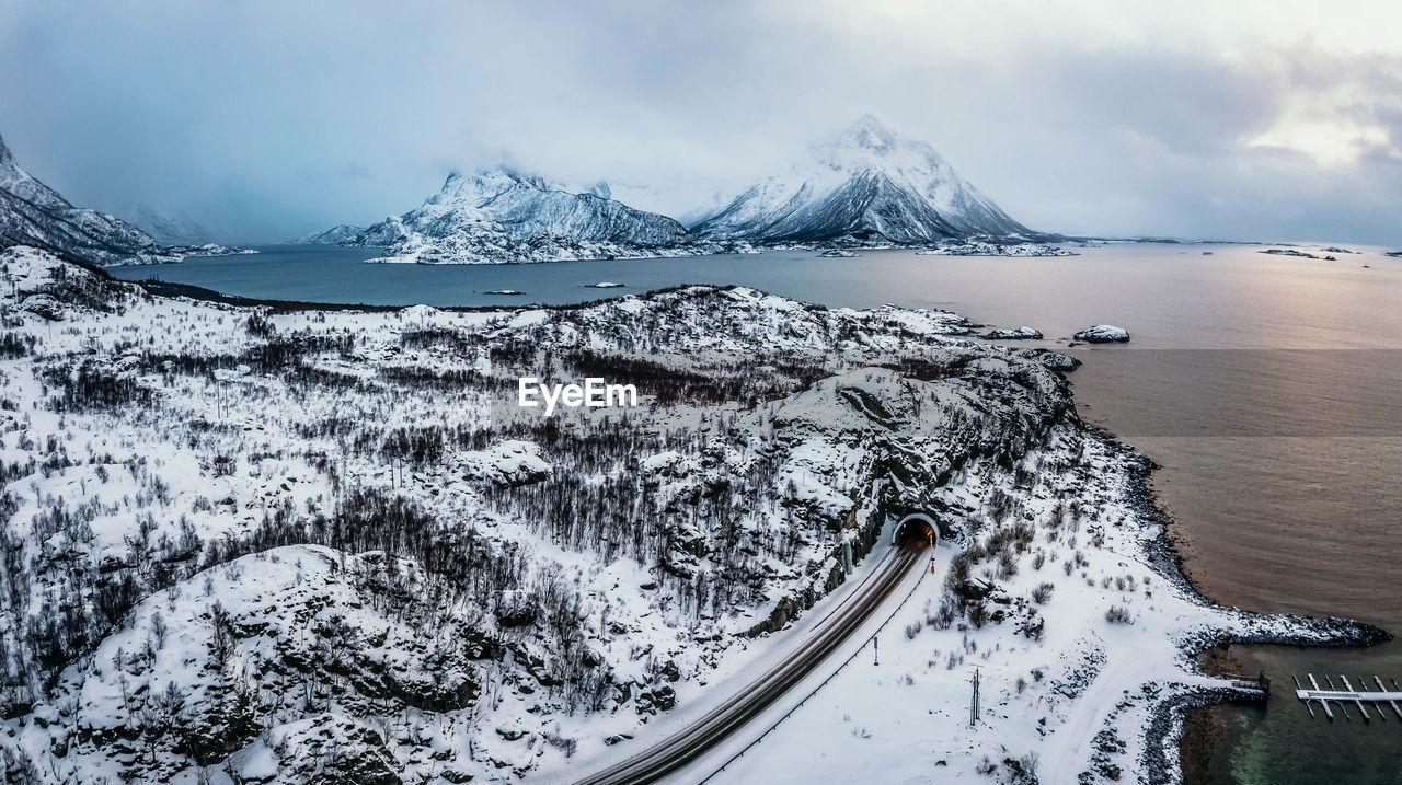 winter, cold temperature, snow, beauty in nature, sky, scenics - nature, mountain, tranquil scene, nature, water, no people, snowcapped mountain, cloud - sky, tranquility, environment, non-urban scene, day, white color, outdoors, ice