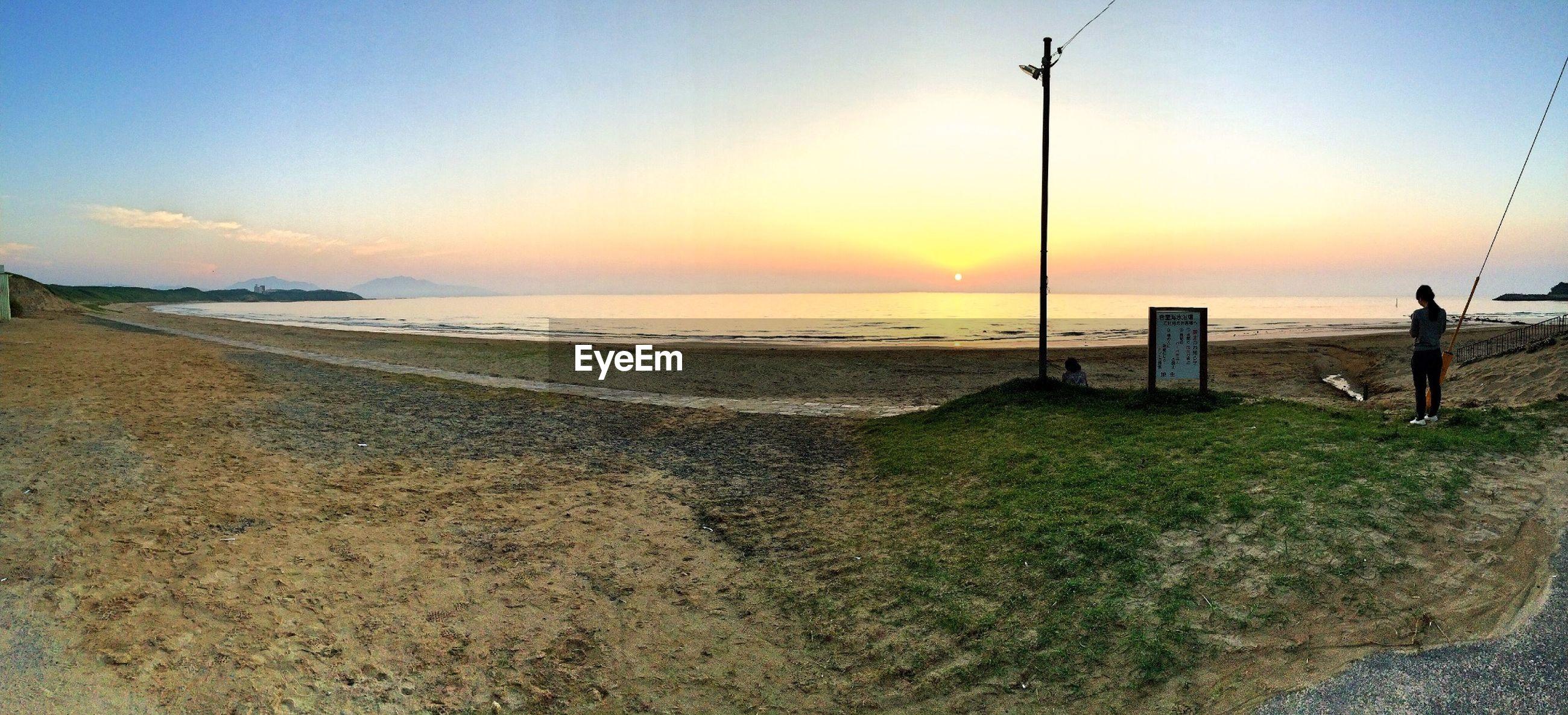 sea, horizon over water, beach, sunset, water, shore, tranquil scene, scenics, tranquility, beauty in nature, sky, orange color, sand, idyllic, nature, sun, coastline, sunlight, incidental people, outdoors