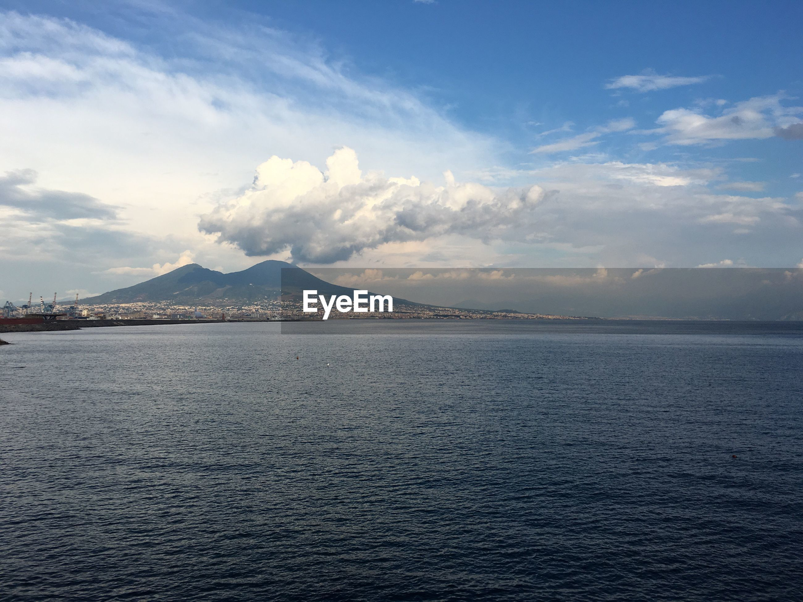 Scenic view of gulf of naples against sky