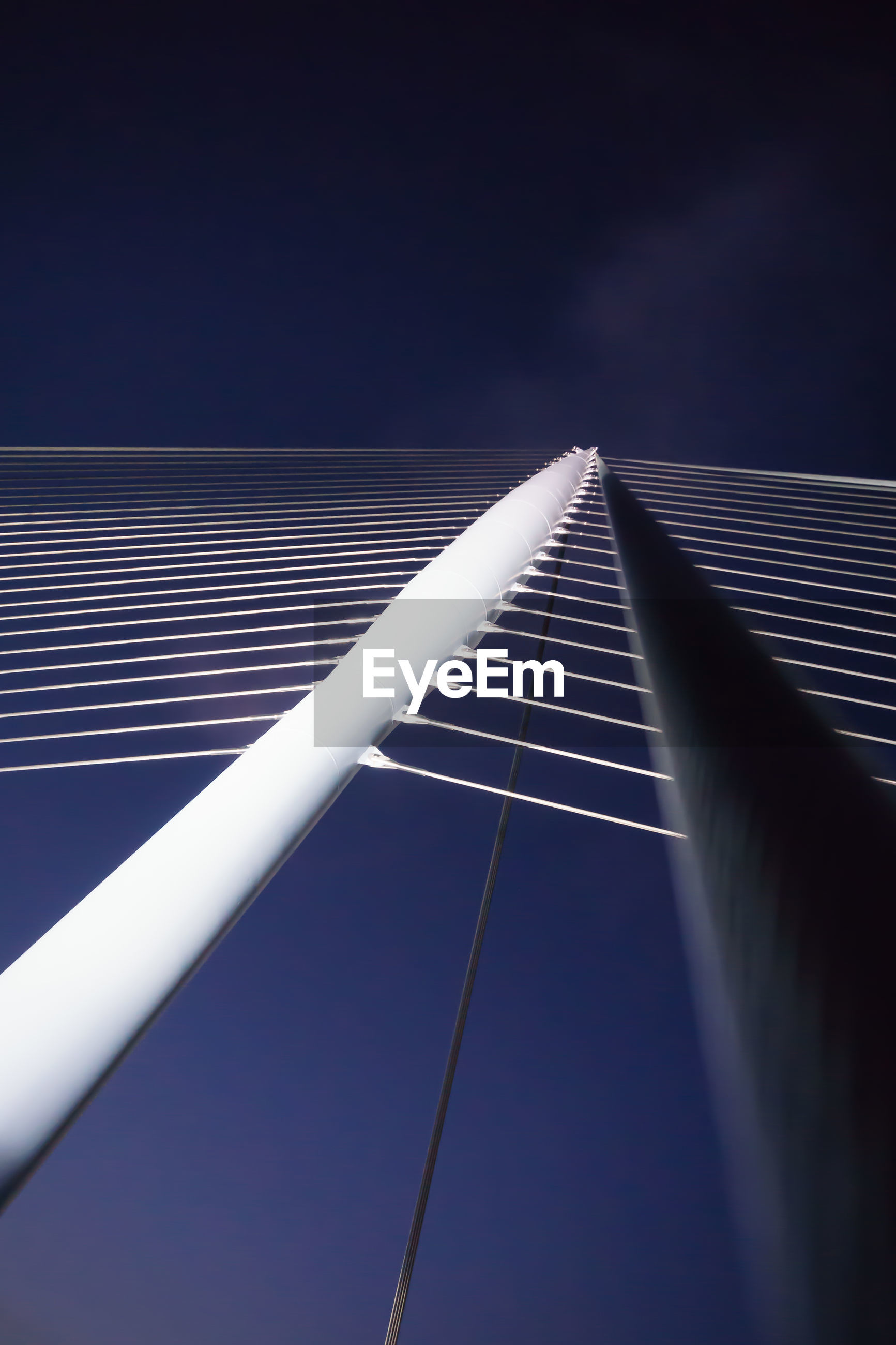 LOW ANGLE VIEW OF ILLUMINATED BRIDGE AGAINST SKY