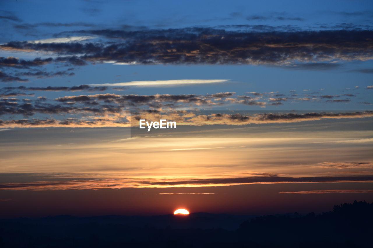 sky, cloud - sky, sunset, beauty in nature, scenics - nature, tranquility, tranquil scene, nature, no people, orange color, environment, idyllic, outdoors, silhouette, landscape, mountain, sun, non-urban scene, sunlight, horizon, romantic sky