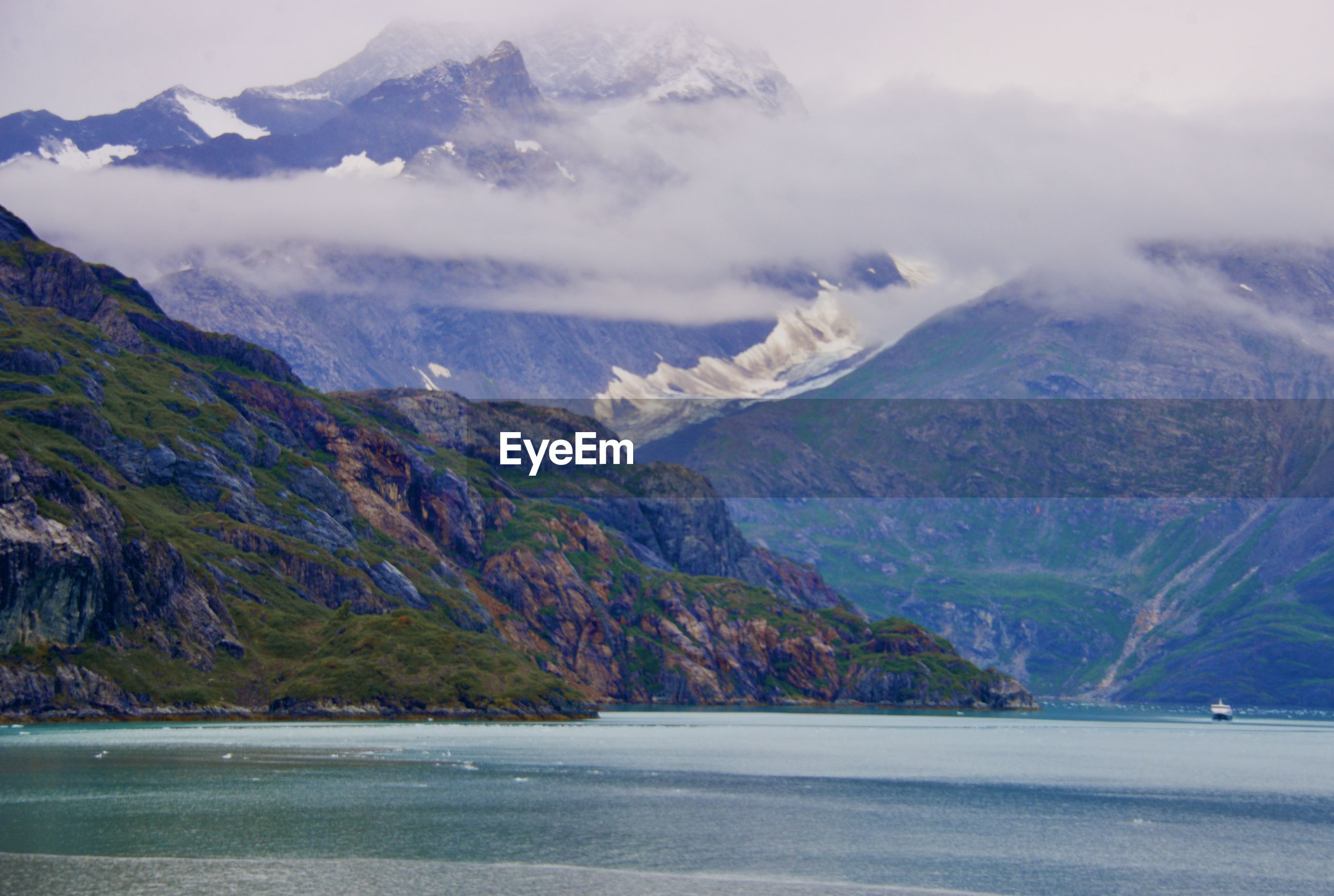 Scenic view of mountains and sea against sky