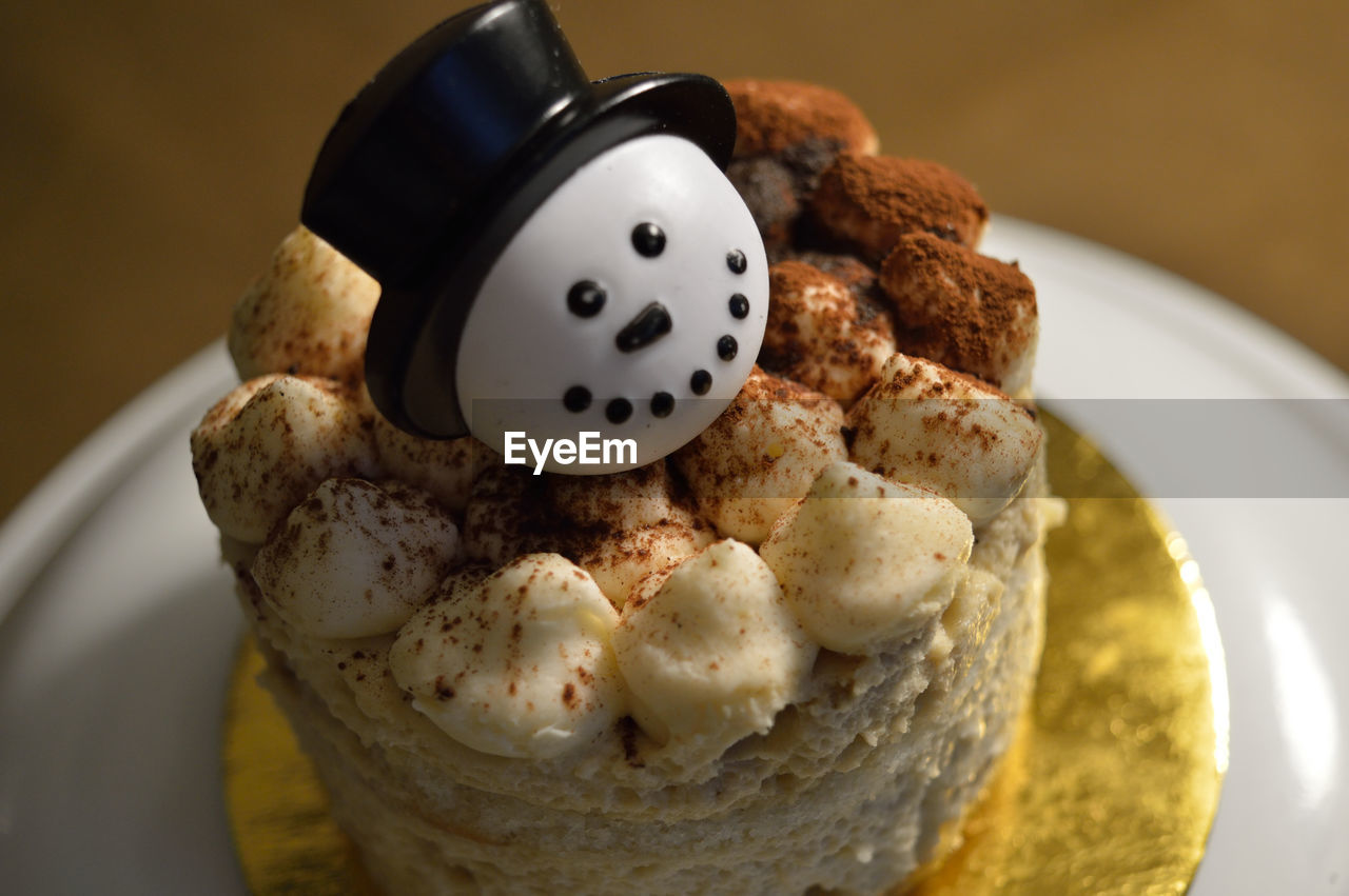 High Angle View Of Dessert With Snowman