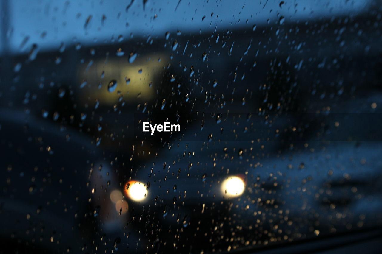 rain, wet, drop, raindrop, window, weather, rainy season, glass - material, water, indoors, no people, illuminated, full frame, night, focus on foreground, storm cloud, close-up, sky, nature