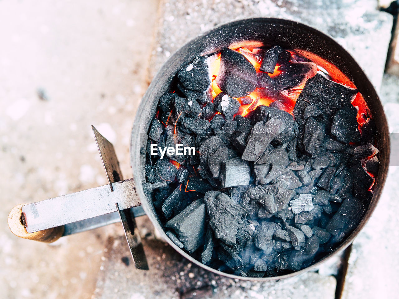Directly Above Shot Of Burning Coals In Fire Pit