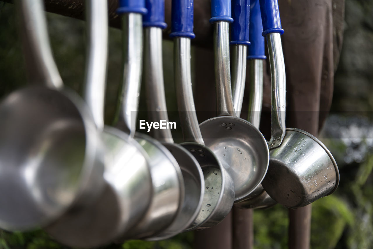 Close-up of wet utensils hanging at jeolmul natural recreation forest
