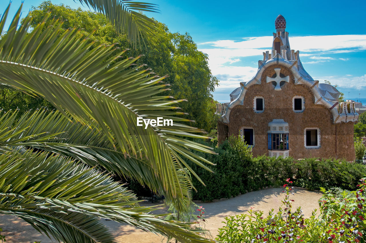 day, outdoors, architecture, building exterior, no people, built structure, tree, spirituality, place of worship, sky, palm tree, nature