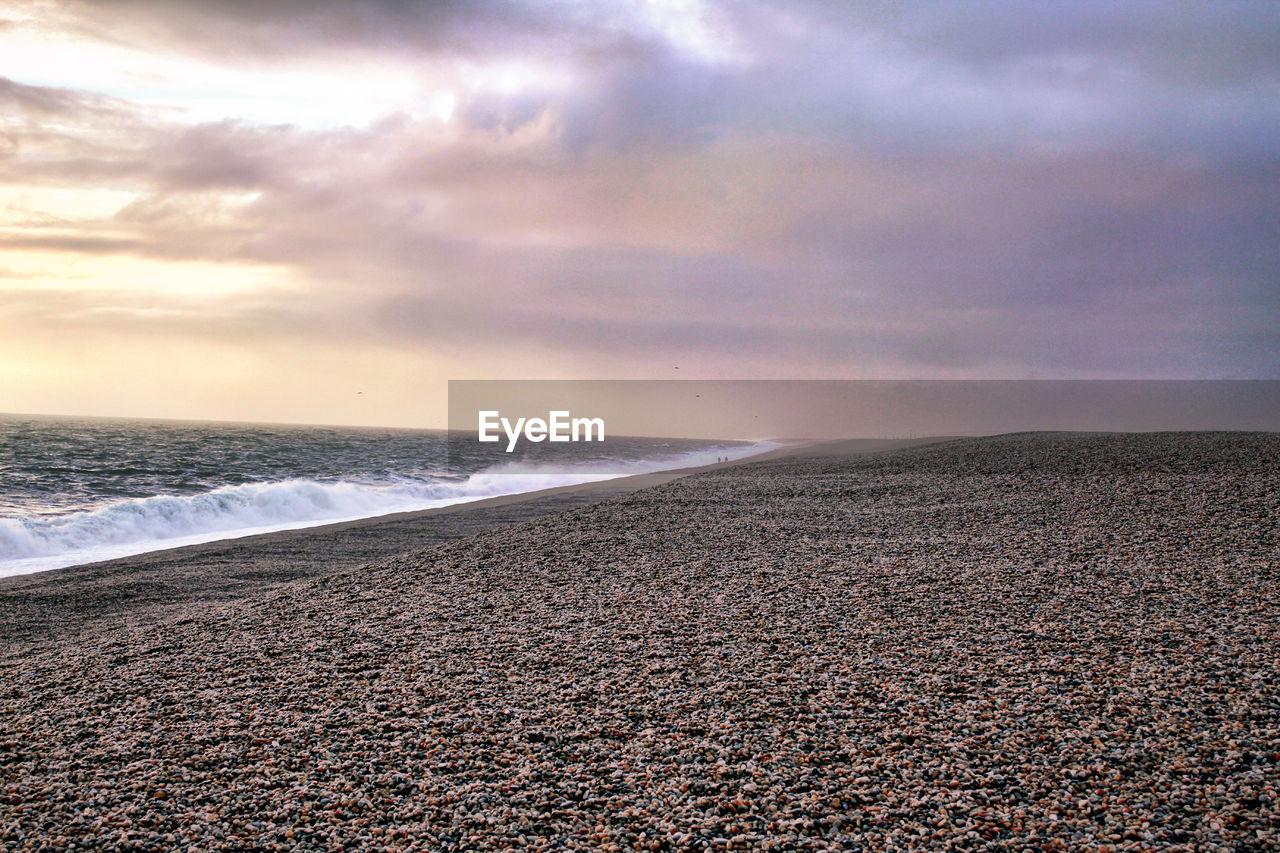 sky, sea, cloud - sky, land, water, beach, beauty in nature, scenics - nature, horizon, tranquil scene, horizon over water, tranquility, nature, no people, sunset, non-urban scene, idyllic, sand, outdoors, pebble