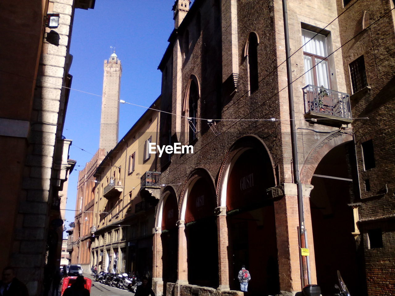 architecture, built structure, building exterior, arch, architectural column, low angle view, day, history, outdoors, real people, city, sky