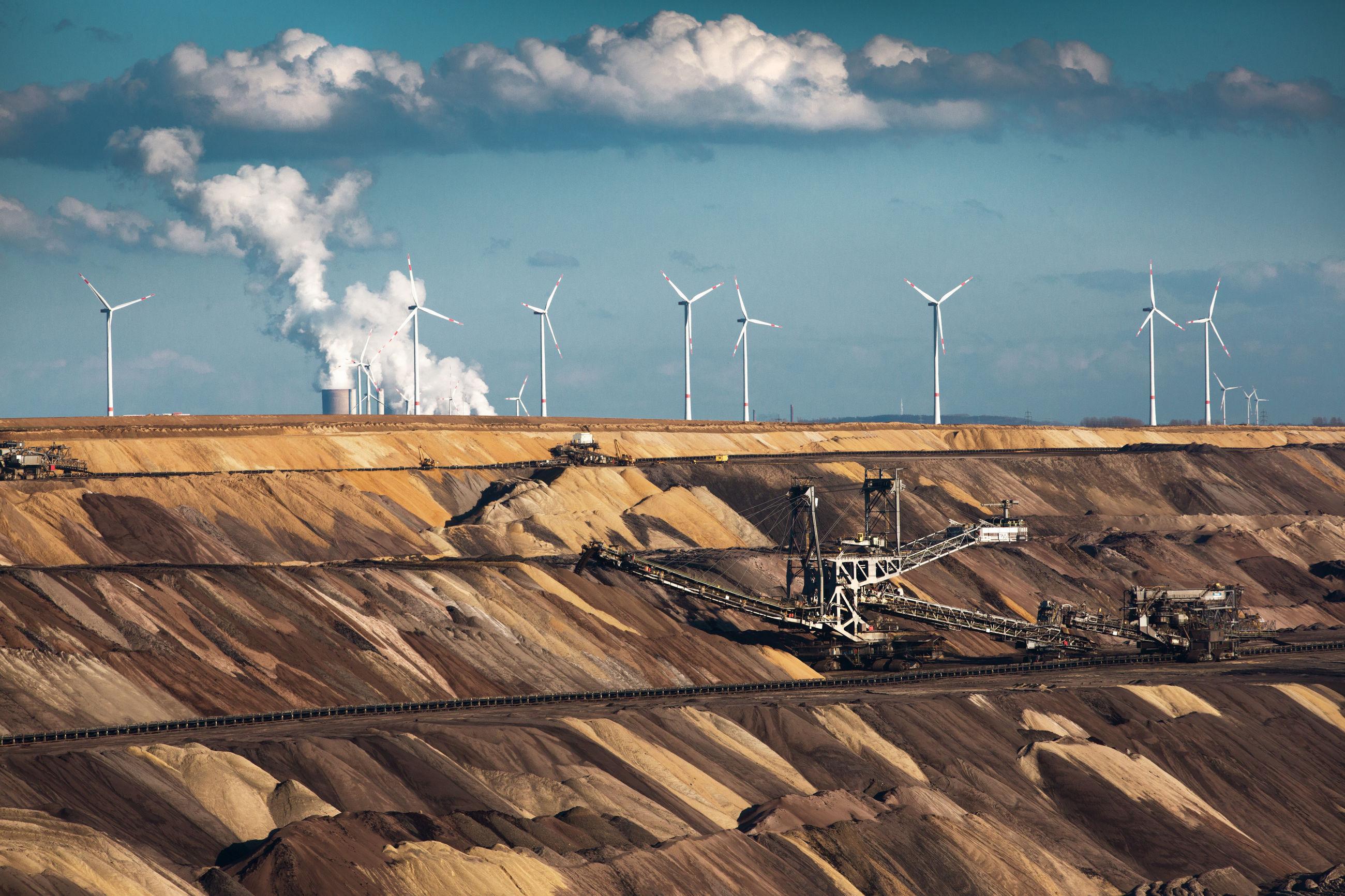 Wind turbines against sky