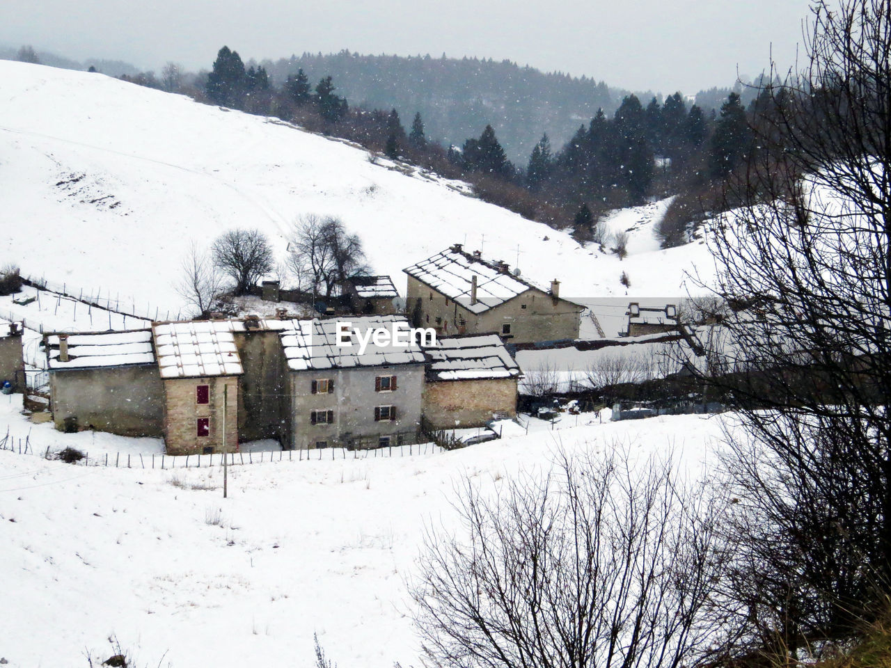 snow, cold temperature, winter, built structure, architecture, weather, building exterior, house, tree, nature, beauty in nature, scenics, no people, outdoors, bare tree, tranquil scene, tranquility, landscape, day, mountain, sky