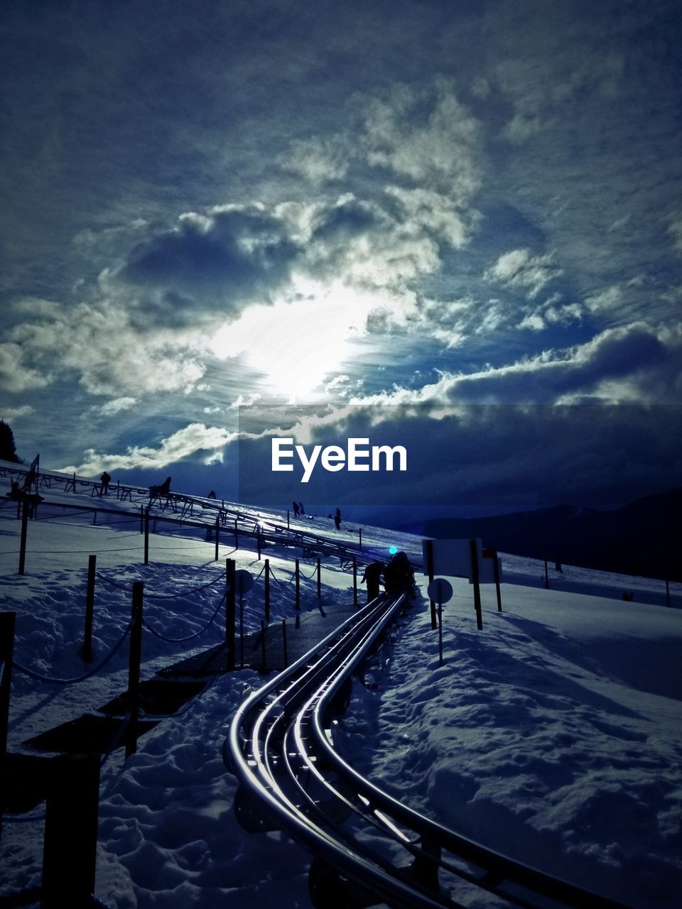 railing, sky, cloud - sky, outdoors, nature, sunlight, sunset, no people, beauty in nature, snow, scenics, day, winter, sea
