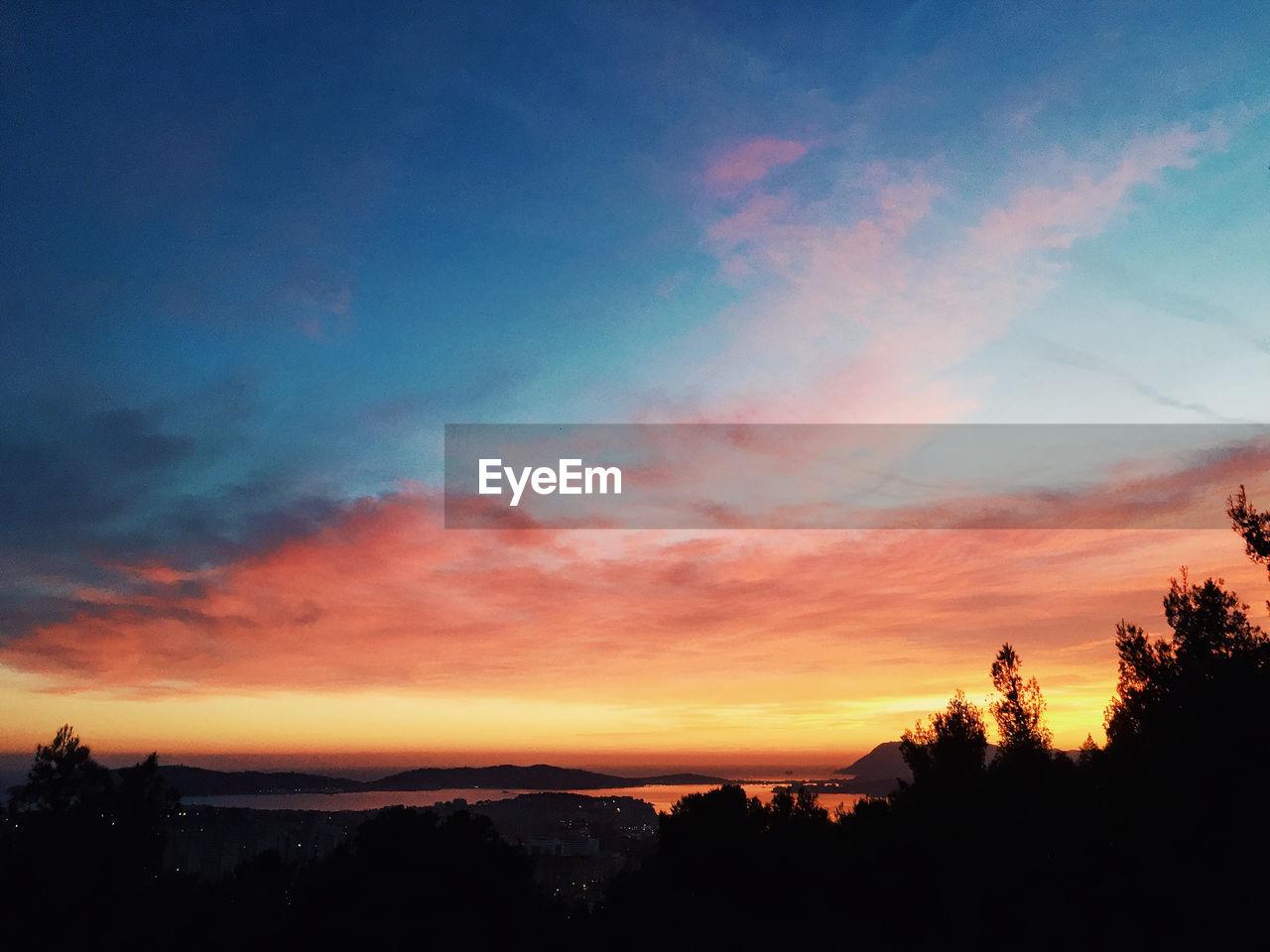 SCENIC VIEW OF SILHOUETTE LANDSCAPE AGAINST ROMANTIC SKY