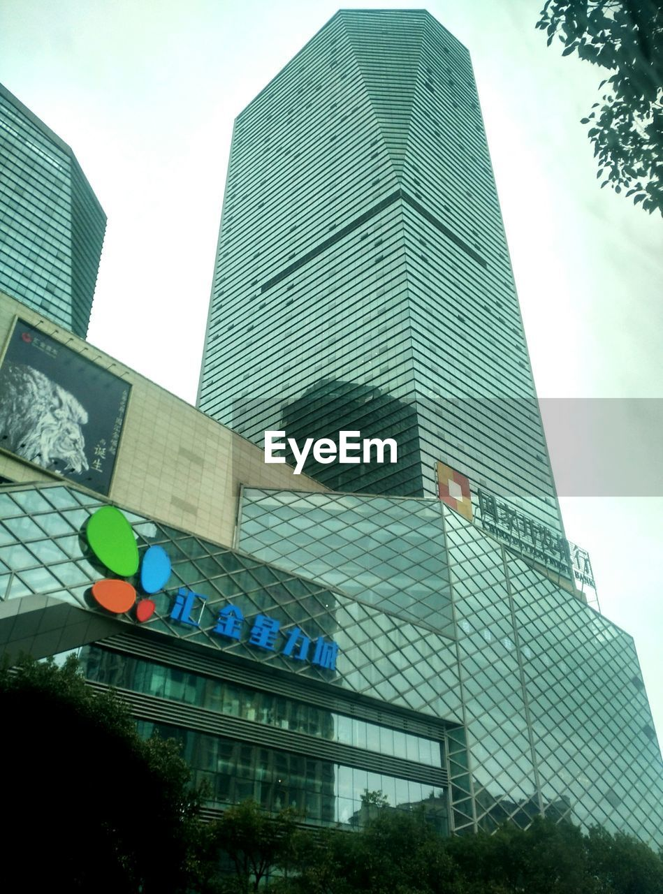 architecture, building exterior, skyscraper, built structure, low angle view, modern, city, day, outdoors, city life, no people, growth, tall, corporate business, sky