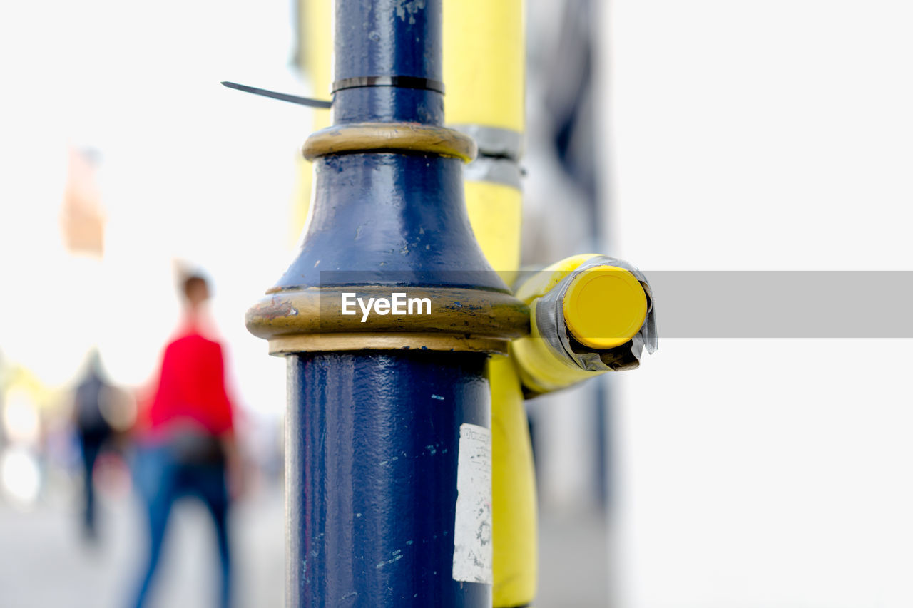 metal, focus on foreground, close-up, day, yellow, real people, outdoors