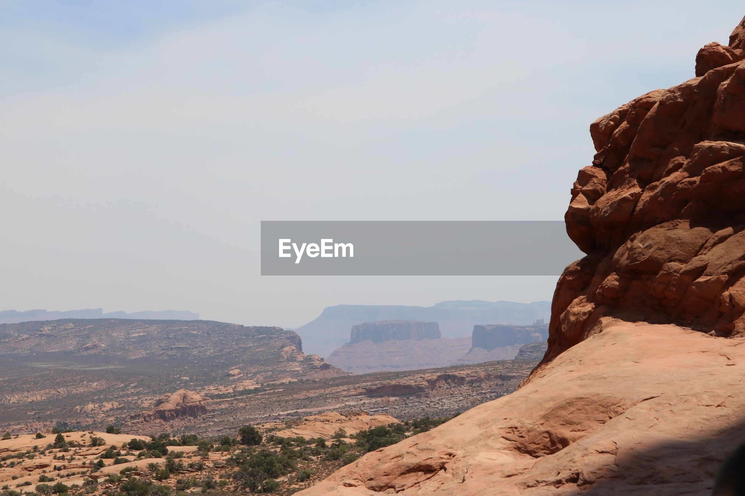 Rock formations at arches national park against sky