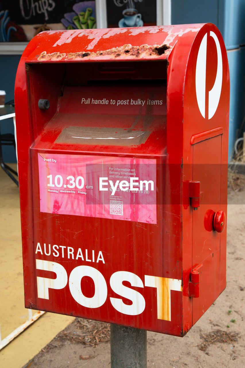 communication, red, text, western script, mailbox, mail, public mailbox, letter, no people, day, close-up, correspondence, focus on foreground, outdoors, convenience, metal, architecture, box, sign, city