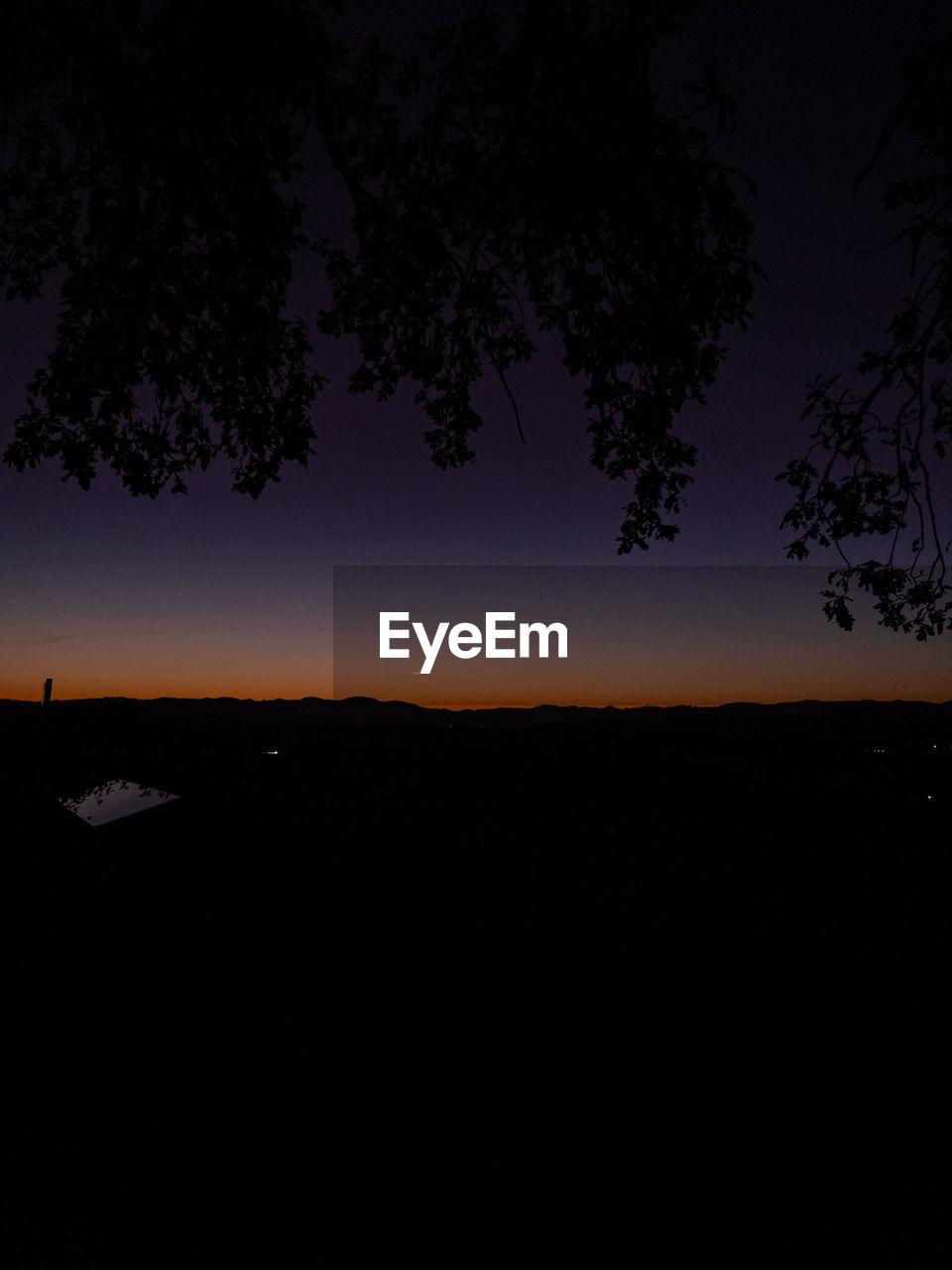 sky, tree, silhouette, scenics - nature, beauty in nature, tranquil scene, tranquility, nature, plant, environment, landscape, night, no people, sunset, outdoors, non-urban scene, dark, dusk, land, idyllic