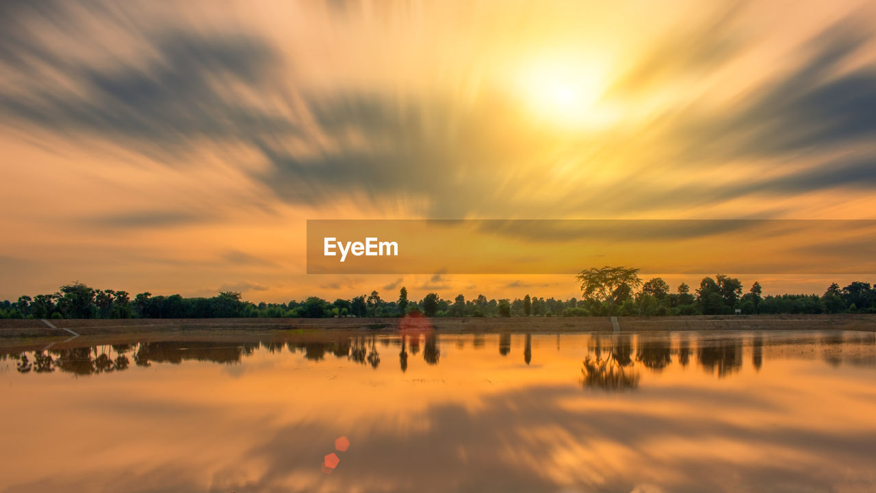 sky, sunset, water, cloud - sky, orange color, beauty in nature, scenics - nature, reflection, nature, lake, tranquility, no people, tranquil scene, tree, idyllic, waterfront, plant, architecture, built structure