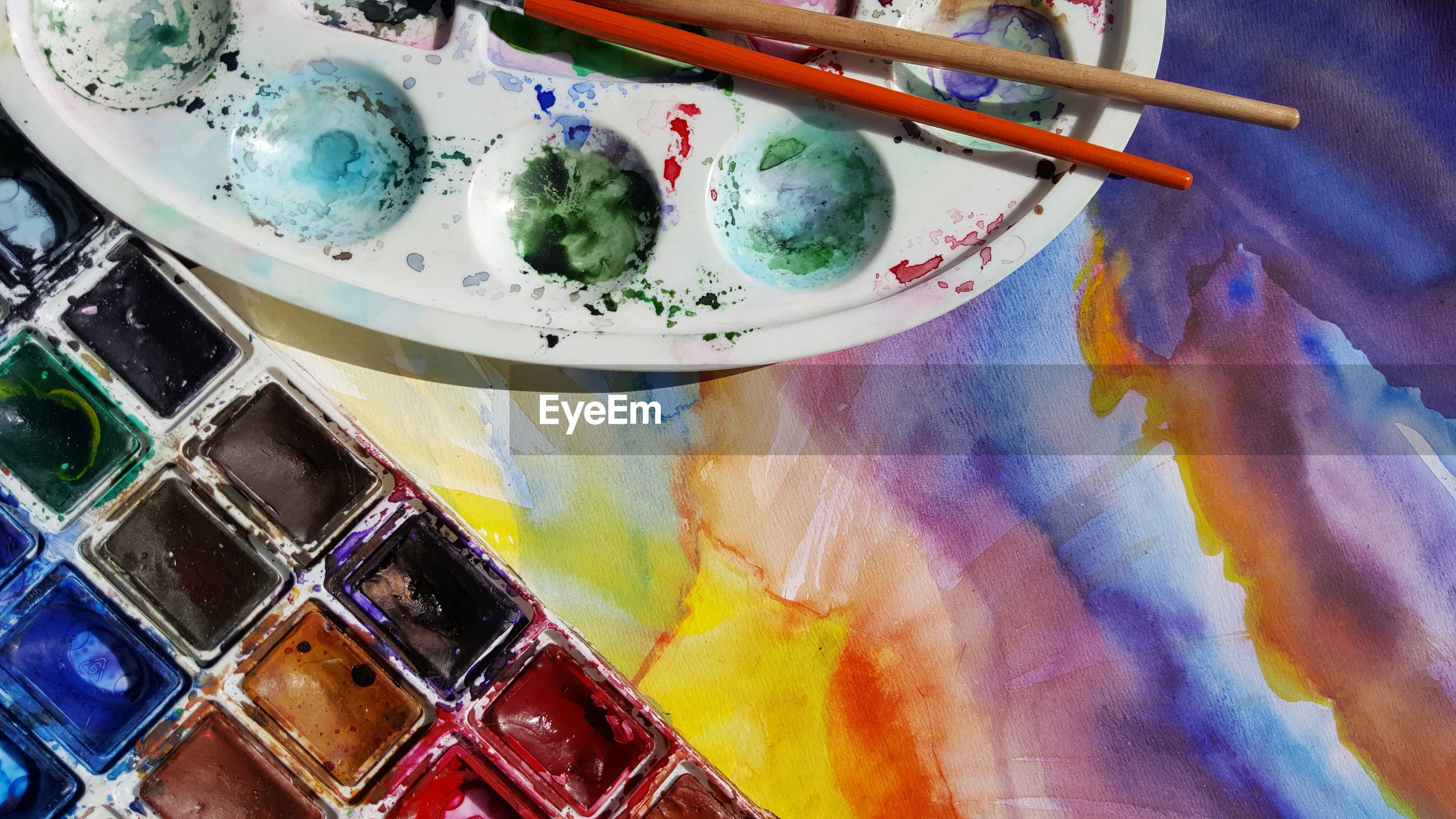 High angle view of palette on colorful painting