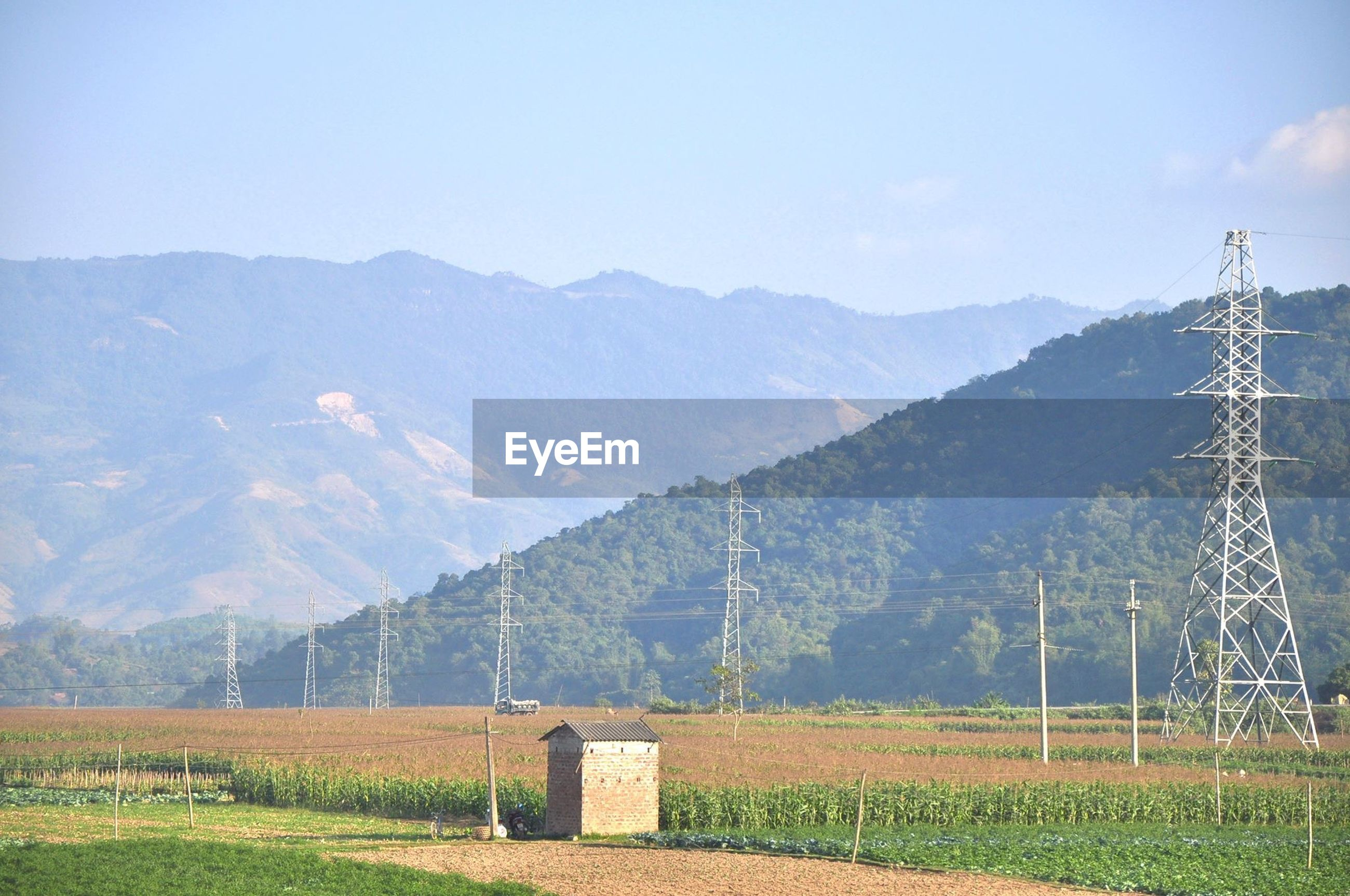 landscape, field, fuel and power generation, rural scene, electricity pylon, tranquil scene, mountain, tranquility, agriculture, electricity, alternative energy, scenics, technology, grass, farm, wind power, wind turbine, nature, beauty in nature, power supply