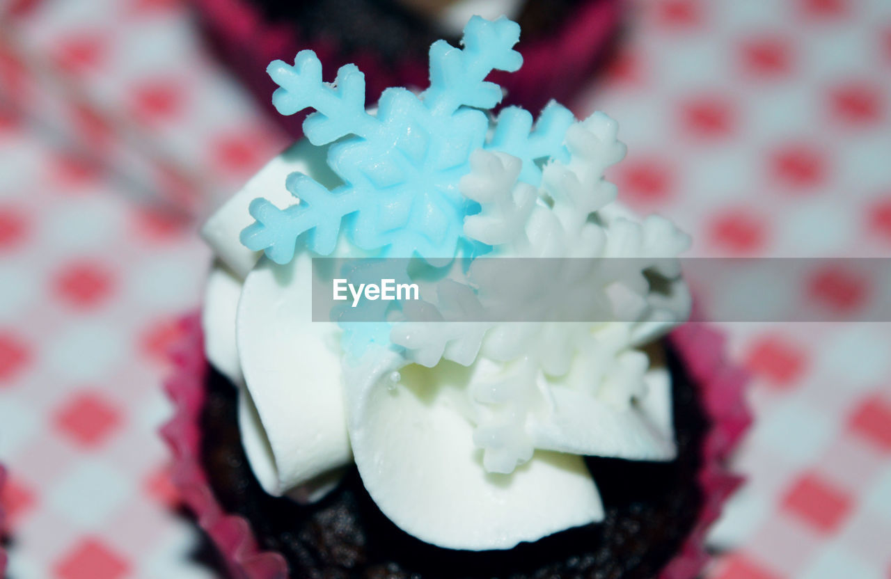 sweet food, food and drink, indulgence, food, dessert, still life, white color, freshness, unhealthy eating, temptation, indoors, no people, celebration, table, ready-to-eat, close-up, cupcake, dessert topping, day