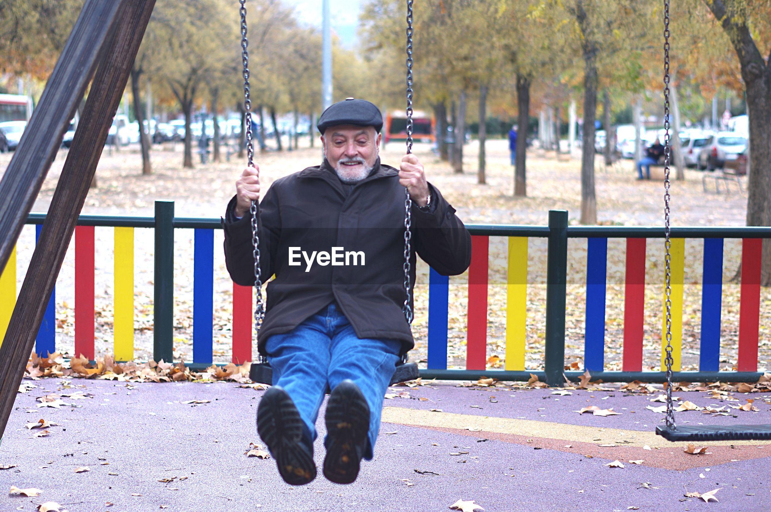 Senior man enjoying swing