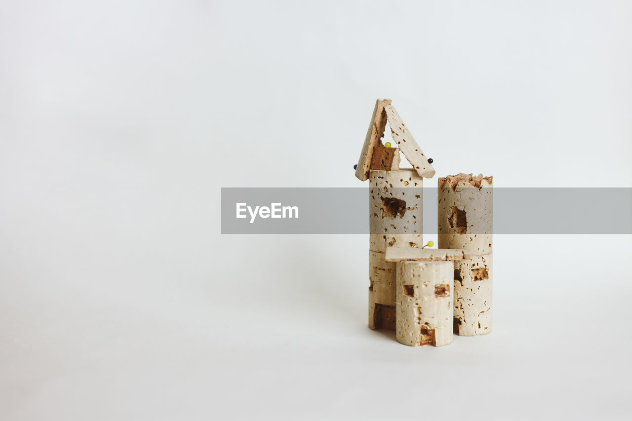 Close-up of toy castle against white background