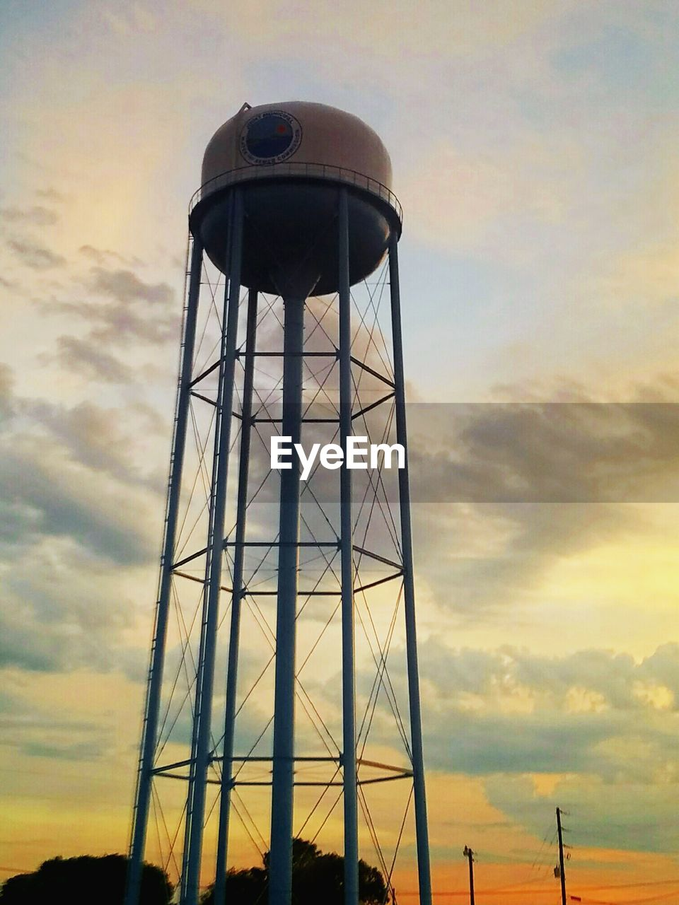 sky, architecture, built structure, cloud - sky, low angle view, storage tank, water tower - storage tank, water conservation, day, sunset, no people, outdoors, nature