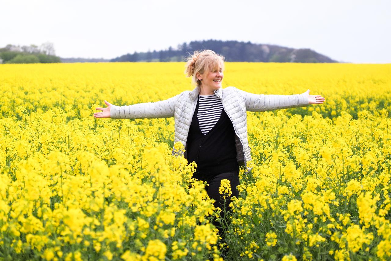 Happy woman on field